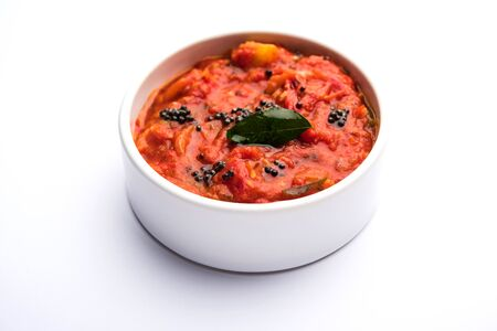 Tomato/tamatar chutney or sauce, served in a bowl. selective focus Archivio Fotografico