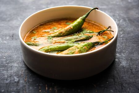 Hyderabadi mirch/mirchi ka Salan or green chilly sabzi or curry. Main course recipe from India. served in a bowl. selective focus