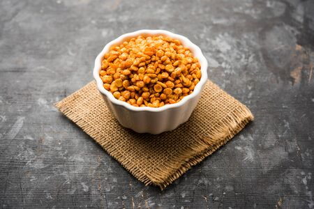 Fried and Spicy Chana Dal Masala is a popular Chakna recipe. Served in a bowl. Selective focus
