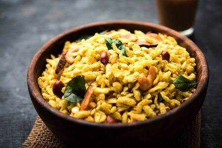 Jada Poha Namkeen Chivda / Thick Pohe Chiwda is a jar snack with a mix of sweet, salty and nuts flavours, selective focus
