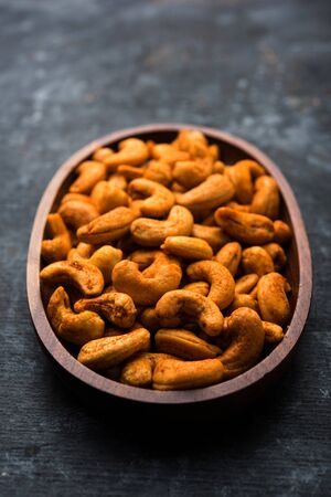 Masala Kaju or spicy Cashew in a bowl. Popular festival snack from Indiaasia, also known as Chakna recipe Reklamní fotografie