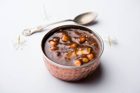 ambrosia or Panchamrit or Panchamrut or Panchamrutham or Panchamrutha is a sweet and sour food offered in prayers or puja to hindu Deity or gods Stock Photo