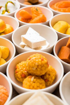 Rangoli of Assorted Indian sweets/mithai in bowl for Diwali or any other festivals, selective focus Imagens