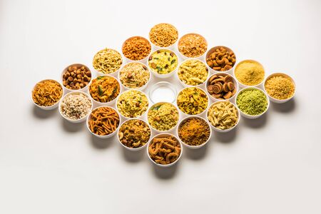 Rangoli of Farsan/snacks in bowls for Diwali with diya Imagens