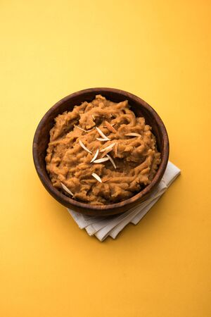 Wheat flour Halwa or Shira or porridge /  Atte ka Halva, Popular healthy dessert or breakfast menu from India. served in a bowl or plate. selective focus