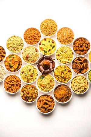 Rangoli of Farsan/snacks in bowls for Diwali with diya