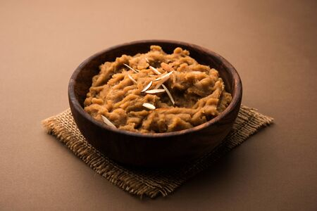 Wheat flour Halwa or Shira or porridge   Atte ka Halva, Popular healthy dessert or breakfast menu from India. served in a bowl or plate. selective focus