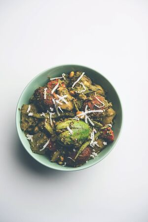 Undhiyu is a Gujarati mixed vegetable dish, specialty of Surat, India. Served in a bowl with or without poori Stock Photo - 130719111