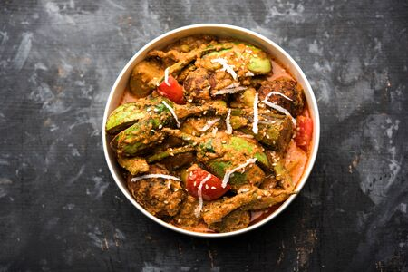 Undhiyu is a Gujarati mixed vegetable dish, specialty of Surat, India. Served in a bowl with or without poori
