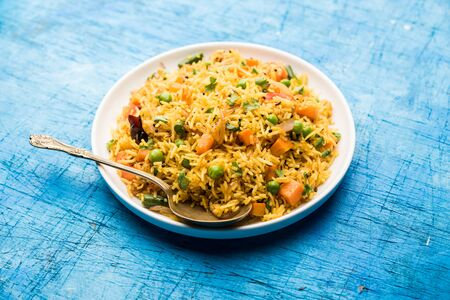 Tawa Pulao/Pulav/Pilaf/Pilau is an Indian Street Food  made using basmati rice, vegetables and spices. Selective focus