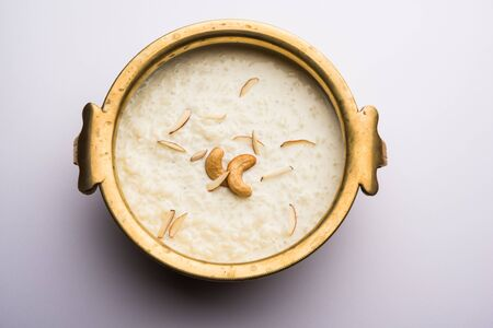 Rice Kheer or Firni or Chawal ki Khir is a pudding from Indian subcontinent, made by boiling milk, sugar and rice. Served in a bowl Imagens