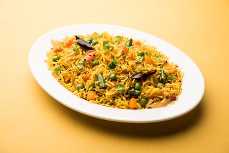 Tawa PulaoPulavPilafPilau is an Indian Street Food  made using basmati rice, vegetables and spices. Selective focus