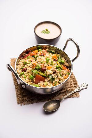 Broken wheat or Daliya Upma, served in wok bowl. selective focus Stock Photo