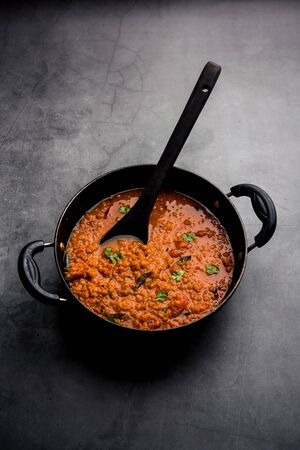 Red Lentil Cooked Dal or Dhal or Masoor daal tadka served in a bowl, selective focus Banco de Imagens