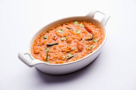 Red Lentil Cooked Dal or Dhal or Masoor daal tadka served in a bowl, selective focus Archivio Fotografico - 131145654