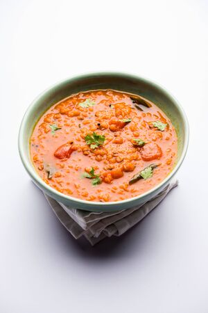 Red Lentil Cooked Dal or Dhal or Masoor daal tadka served in a bowl, selective focus Archivio Fotografico - 131145666