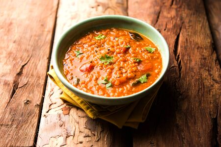 Red Lentil Cooked Dal or Dhal or Masoor daal tadka served in a bowl, selective focus 版權商用圖片
