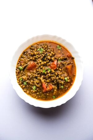 Whole Green Moong Dal fry / Whole Mung bean Tadka served in a bowl. selective focus Archivio Fotografico - 131145692