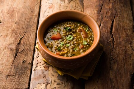 Whole Green Moong Dal fry / Whole Mung bean Tadka served in a bowl. selective focus Archivio Fotografico - 131145735