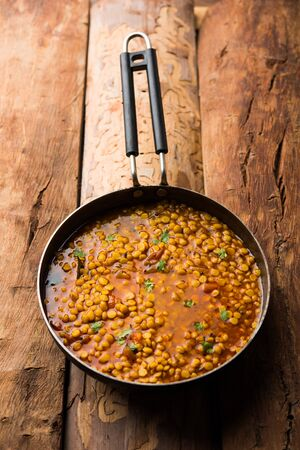 cooked Chana Dal fry or Split Bengal Gram tadka served in a bowl or pan, selective focus Banco de Imagens