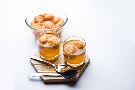 Kanji Vada  wada is a popular Rajasthani detoxifying dish consumed after over eating of sweets in Indian festival season. served in transparent Bowl or glass