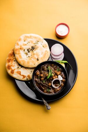 Pindi Chole Kulche or roadside choley Kulcha is a popular streetfood in India and pakistan. It's a spicy Chickpea or chana curry served with Indian Flat Bread.