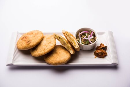 Fried Sattu Litti chokha served with Baingan Bharta, onion and pickle, popular recipe from Bihar, India