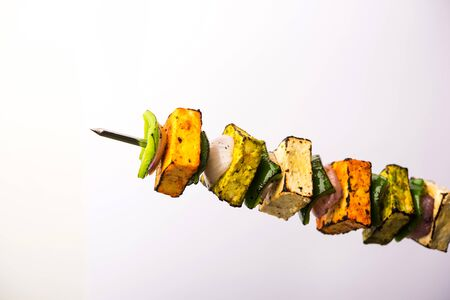 Food  Levitation - Flying Paneer Tikka isolated over white or black background, selective focus