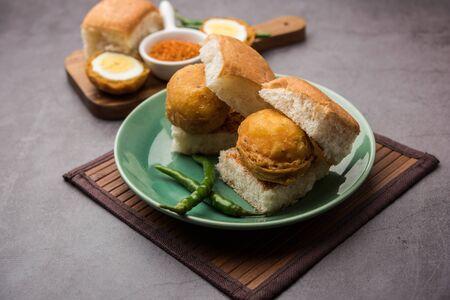 Egg Vada Pav or Anda Wada Paav / Pao is a non-Vegetarian Fast Food Dish From Maharashtra, India