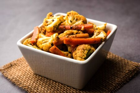 Carrots cauliflowers achar made using PhoolGobi and Gajar. It's a sweet and sore seasonal pickle from India