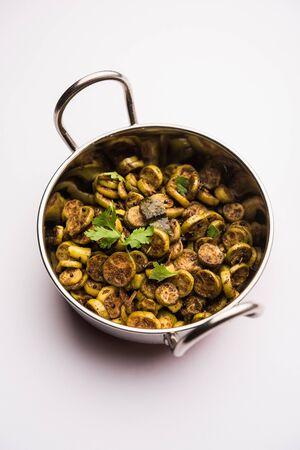 Tendli / Kundroo sabzi or Kovakkai Poriyal also known as ivy gourd, served in a karahi. Stock Photo