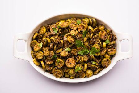 Tendli / Kundroo sabzi or Kovakkai Poriyal also known as ivy gourd, served in a ceramic bowl.