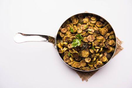 Tendli / Kundroo sabzi or Kovakkai Poriyal also known as ivy gourd, served in a cooking pan