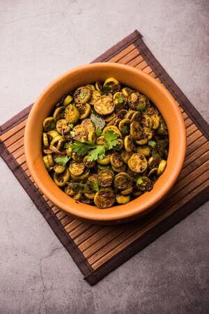 Tendli / Kundroo sabzi or Kovakkai Poriyal also known as ivy gourd, served in a bowl. Stock Photo