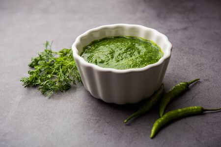 Kothimbir or Dhaniya Chutney made using cilantro or coriander with chilli, served in a bowl.