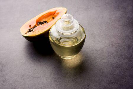 Papaya seed oil with raw papita. Stock fotó