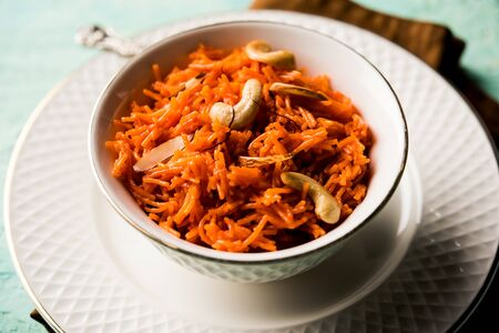 Vermicelli  / Semiya Kesari is a popular indian sweet served in a bowl, garnished with dry fruits like cashew and almond, made in pure ghee Stock Photo