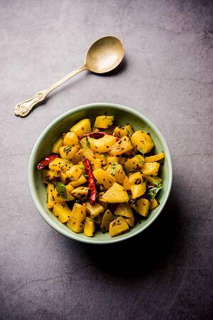 Kaccha Papita Sabji or Raw Papaya Sabzi, served in a karahi or bowl. selective focus