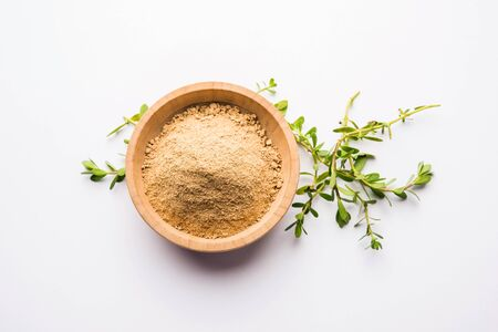 Bacopa monnieri herb plant or Ayurvedic Brahmi plant with powder in a bowl, selective focus