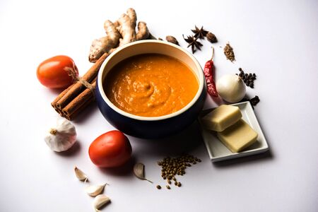 North Indian basic Curry for paneer butter masala or chicken makhanwala recipe shown with ingredients, served in a bowl. selective focus