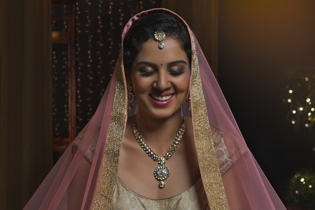Woman in bridal dress smiling with closed eyes