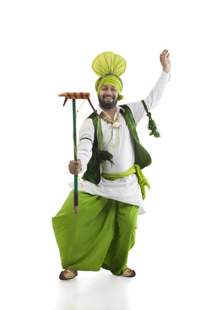 Sikh man holding a Katow