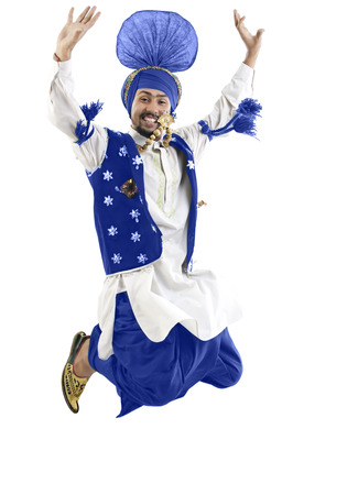 Sikh man jumping in the air