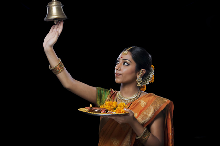 Indian woman performing puja LANG_EVOIMAGES