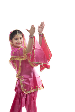 Sikh girl clapping her hands