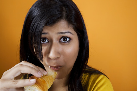 Woman eating a patty