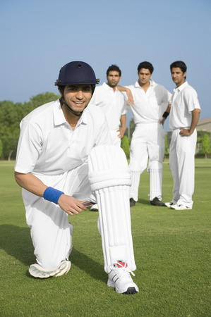 Cricketer wearing his cricket pads