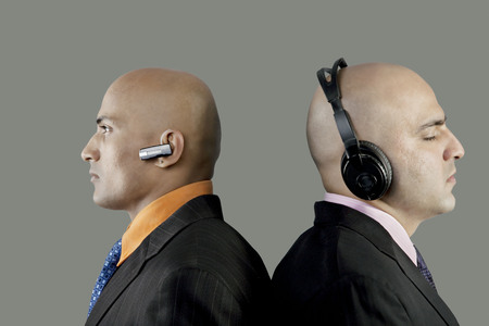 Businessmen with headphones and blue-tooth