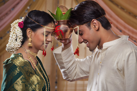 Maharashtrian couple performing traditions before wedding LANG_EVOIMAGES