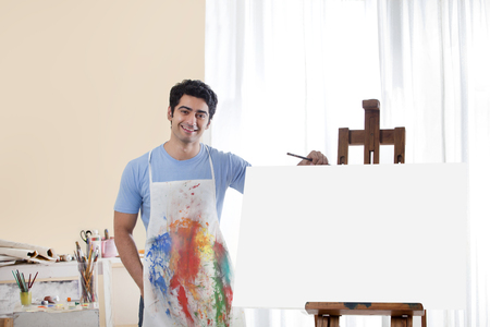 Handsome young man in painting studio